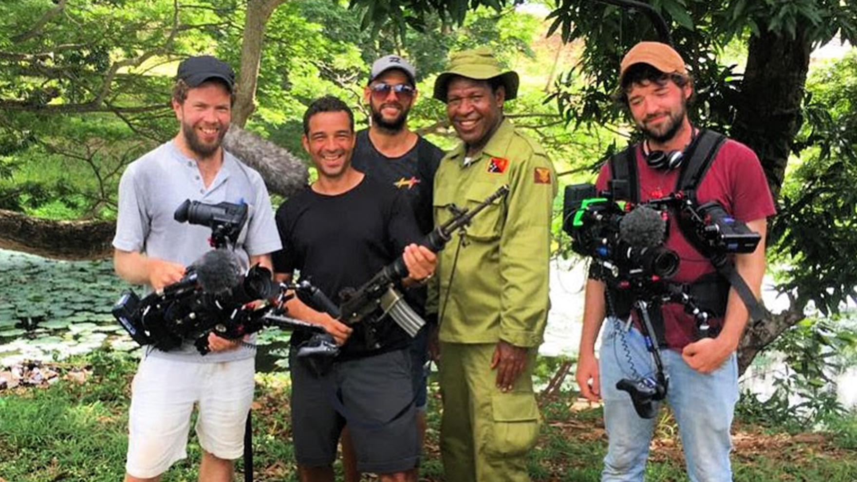 PNG-filming-Crew-with-Guard-_-gun